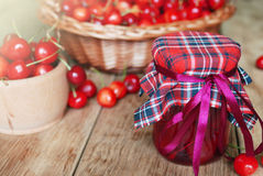 Jar with cherries on the wooden table Stock Images