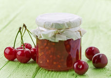 Jar of cherry and apple jam Royalty Free Stock Images