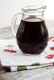 Jar with cherry brandy liqueur a wine Royalty Free Stock Photo