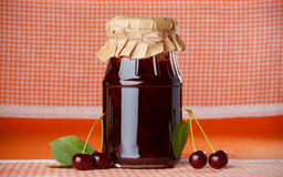 Jar of cherry jam Stock Image
