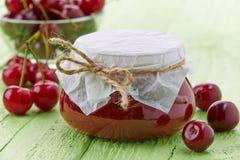 Jar of cherry jam Royalty Free Stock Photos
