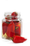Jar with chilli peppers Stock Photos