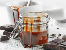 Jar of chocolate sauce Royalty Free Stock Photo
