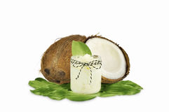 Jar of coconut oil and fresh coconuts Stock Photography