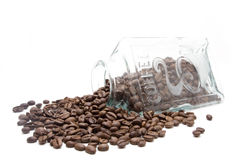 Jar with coffe beans. Glass jar with coffe beans isolated on white background Royalty Free Stock Image