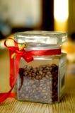 Jar with coffee. Grain on a table and cinnamon stock photos