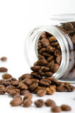 Jar with coffee beans bulk on white background Stock Photos