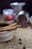 A jar with coffee beans, cinnamon sticks, a sweet chocolate ingredient in a jar,. A tea kettle Royalty Free Stock Photos