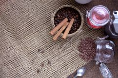 A jar with coffee beans, cinnamon sticks, a sweet chocolate ingredient in a jar,. A tea kettle Royalty Free Stock Photography