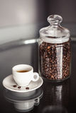 Jar of coffee and espresso cup Stock Images