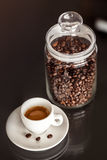 Jar of coffee and espresso cup Royalty Free Stock Image