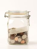 Jar of coins Royalty Free Stock Photography