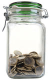 Jar with coins. Isolated closed glass jar full of coins Stock Photography
