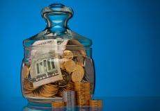 Jar with coins Stock Photos