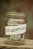 Jar with coins  education. Royalty Free Stock Photography
