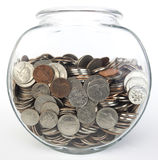Jar of Coins. Glass jar filled with US coins Stock Photo