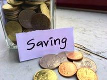 Jar of coins stock photos