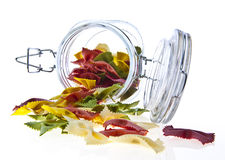 Jar of  coloured pasta isolated Stock Photo
