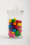 Jar of colourful gumballs. A glass jar with a lid. Filled with colourful gumballs Stock Photos