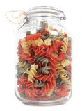 Jar of colourful pasta Royalty Free Stock Image