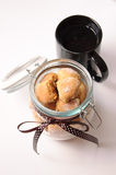 Jar with cookies. And a cup of tea Royalty Free Stock Photos