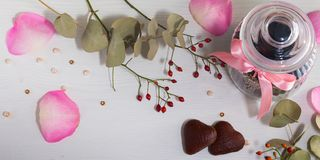Jar for cookies, two cookies in form of heart and dog rose on light gray background. Valentine`s day. stock photography