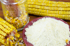 A jar with corn, flour and corn ear Stock Images