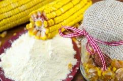 A jar with corn, flour and corn ear Stock Image