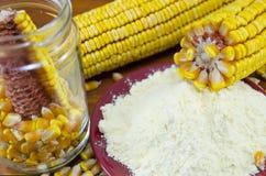 A jar with corn, flour and corn ear Royalty Free Stock Photos