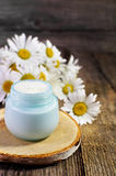 Jar with cosmetic cream on a wooden surface. Stock Photos