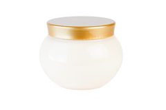 Jar of cream and gold cap. Isolated on white backgound Royalty Free Stock Image