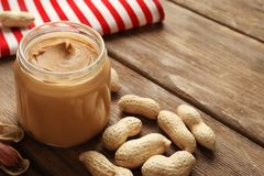 Jar with creamy peanut butter royalty free stock photos