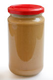 Jar of crunchy peanut butter Stock Photography