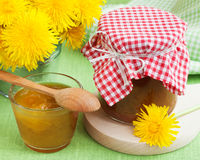Jar of dandelion jam and blowball flowers Royalty Free Stock Photos