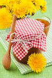 Jar of dandelion jam and blowball flowers Royalty Free Stock Images