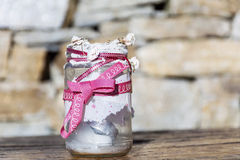 Jar decorated with roses and lace on a stone background .Home decoration Royalty Free Stock Photo