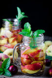 Jar delicious refreshing drink of peach fruits and plum Stock Photos