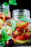 Jar delicious refreshing drink of peach fruits and plum Stock Photo