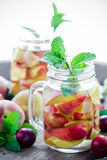 Jar delicious refreshing drink of peach fruits and plum Stock Image