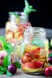 Jar delicious refreshing drink of peach fruits and plum Royalty Free Stock Photography