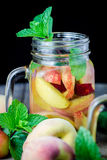 Jar delicious refreshing drink of peach fruits and plum Stock Photography