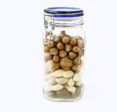 Jar with different nuts. On white background stock images