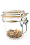 Jar with dried basil Stock Photography