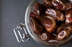 Jar of dried dates, close up, view from above Stock Image