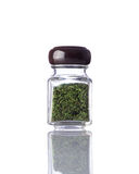 Jar Dried Green Herbs on White Background Royalty Free Stock Photos