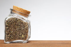 Jar of dried herbs Stock Images