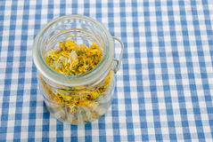 Jar of dried organic herbal healing calendula Stock Images