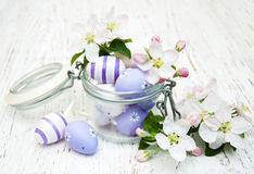 Jar with easter eggs. And spring apple blossom Royalty Free Stock Image