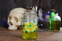 Jar of eyeballs skull and potions Royalty Free Stock Images