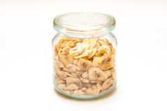 A jar filled with dry bananas Royalty Free Stock Images